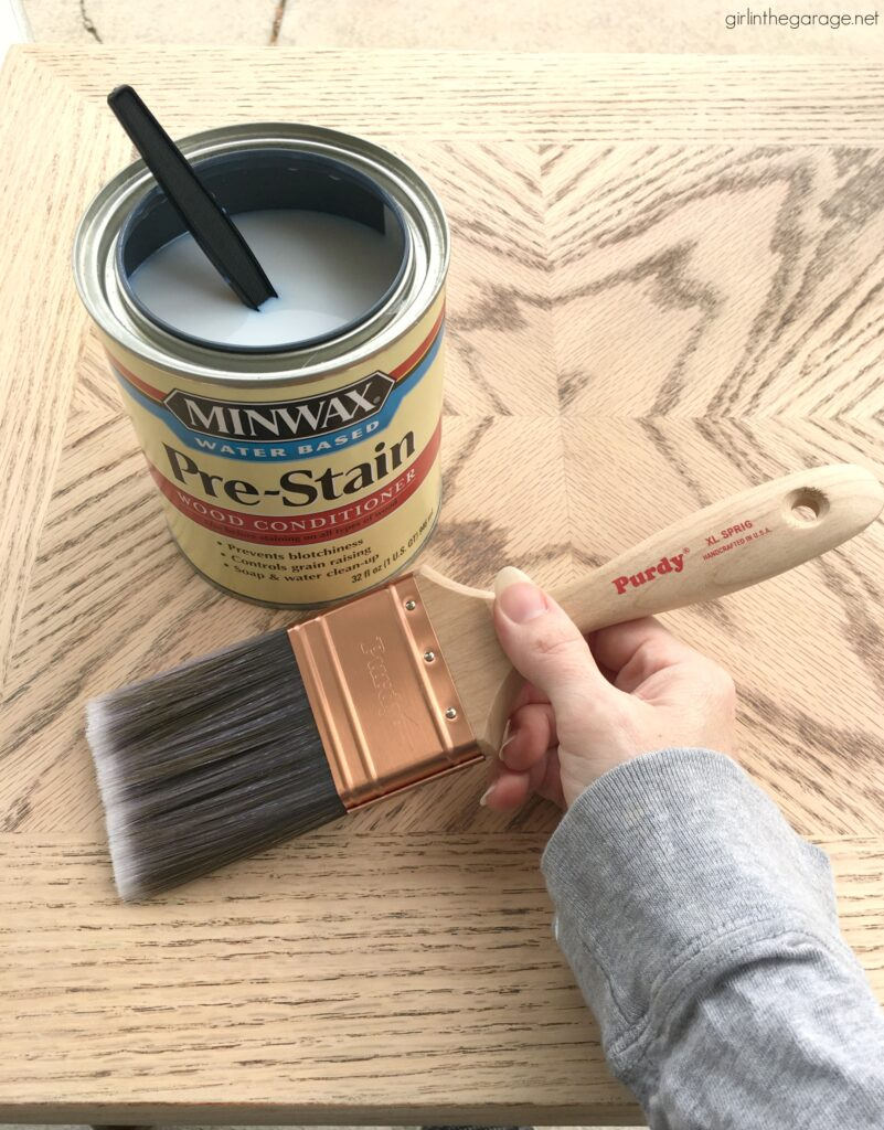 Create a charming modern farmhouse finish with Minwax products on these stained and painted side tables. DIY makeover ideas by Girl in the Garage