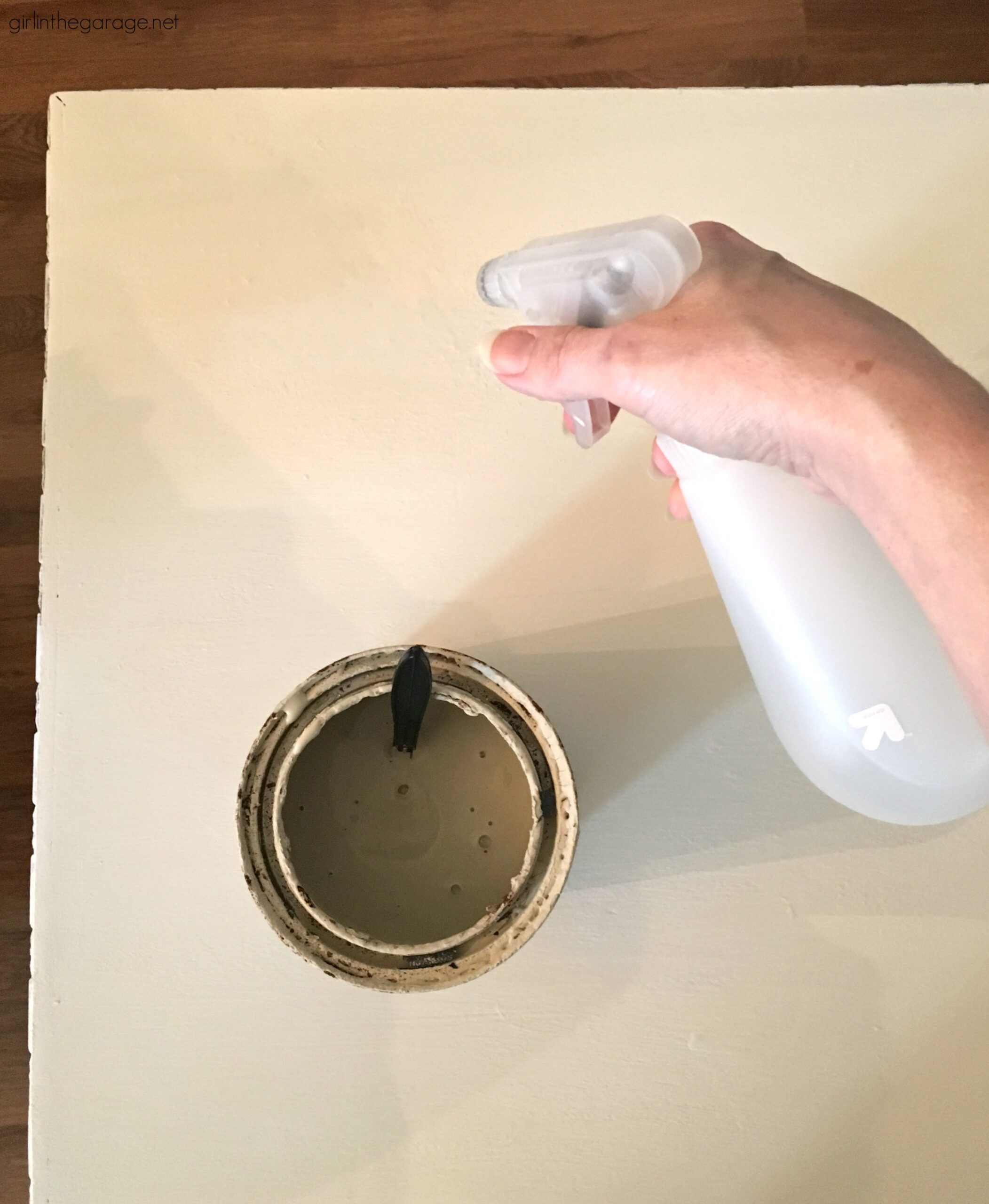 Rescue a poorly-painted antique and transform it into a beautiful French Country side table. Step by step tutorial by Girl in the Garage