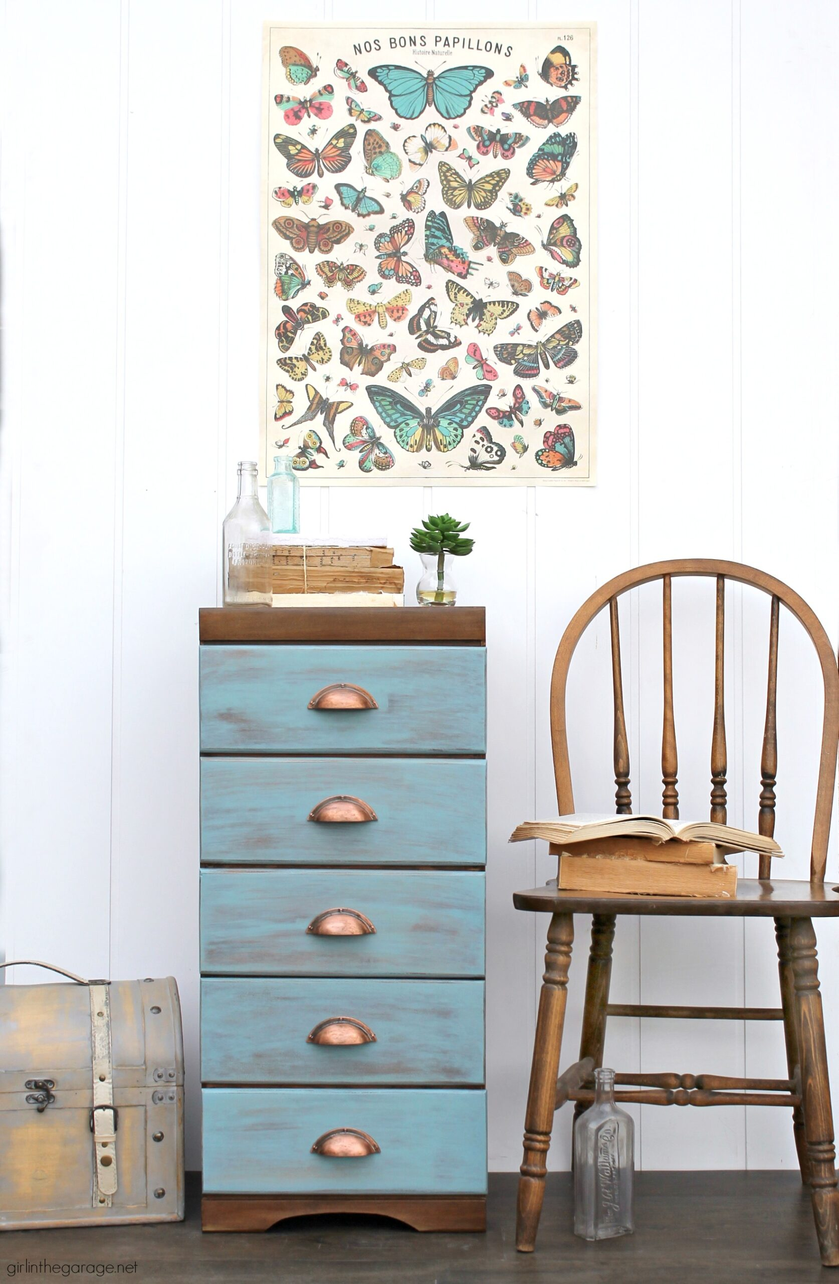 Learn how to refinish a dresser with Minwax products including Vintage Blue, the 2021 Color of the Year. Add faux-aged copper pulls and map paper lined drawers for the finishing touch. #ad DIY makeover ideas by Girl in the Garage