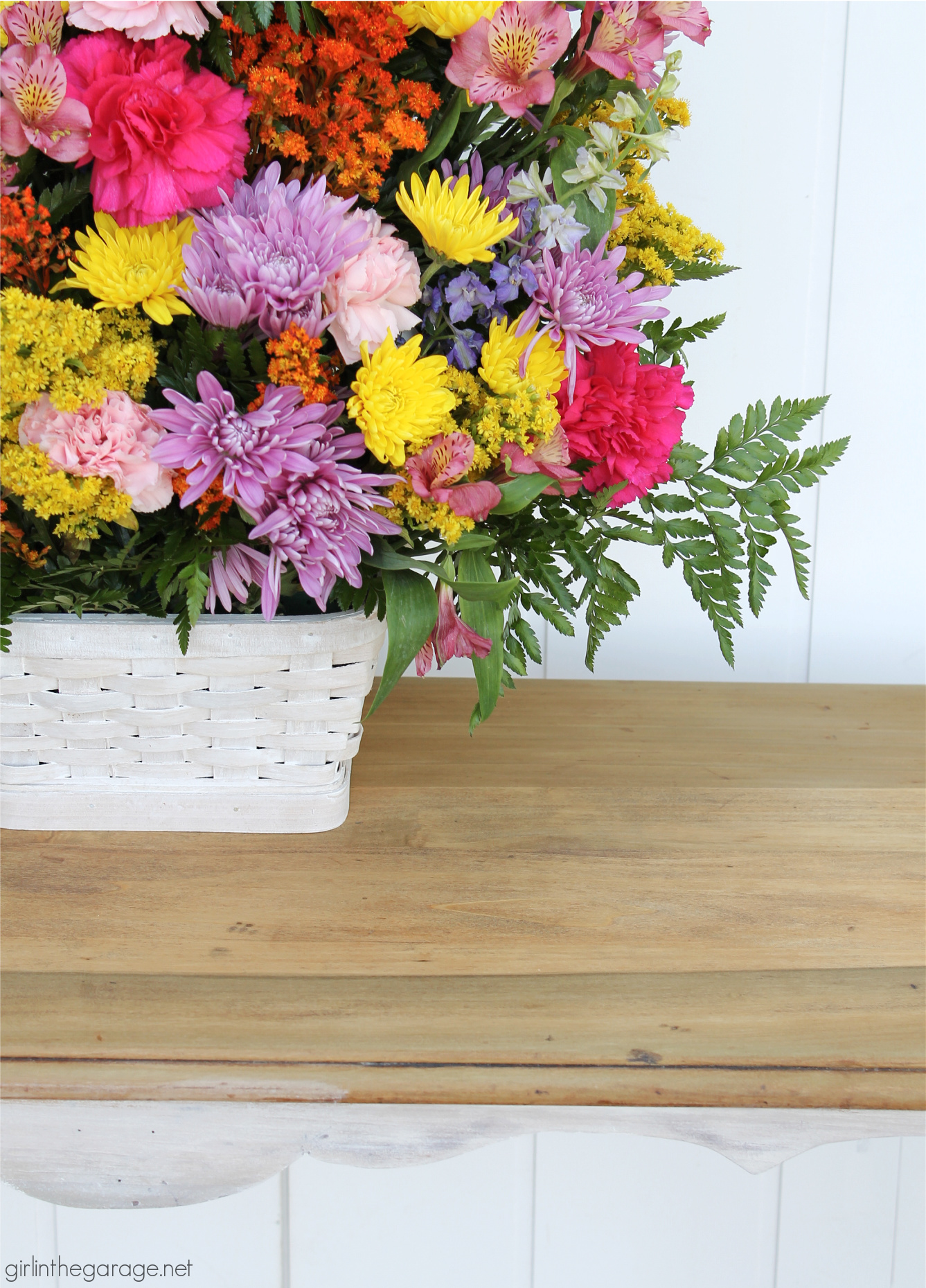 Learn how to create a DIY farmhouse sofa table with just a hint of whitewashed paint on bottom and a gorgeous natural wood top. DIY painted furniture and decor ideas by Girl in the Garage