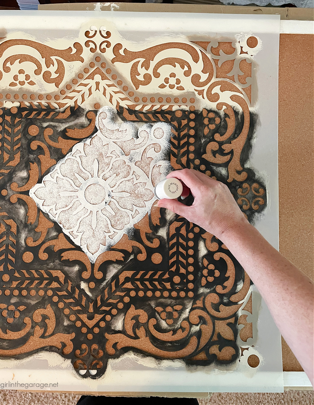 Learn how to paint cork board with a stencil for gorgeous custom home decor. An easy DIY project with step by step tutorial from Girl in the Garage.
